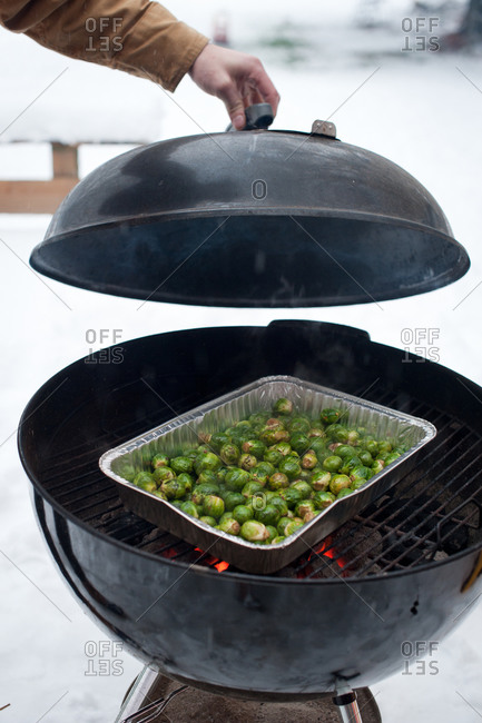 Brussels sprouts roasting on a charcoal grill