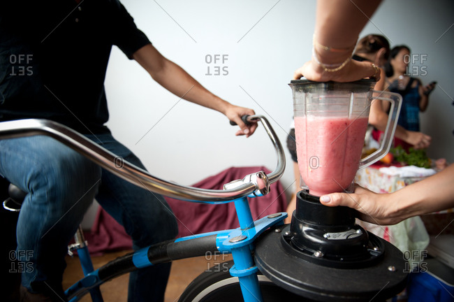 Making smoothies with a bicycle-powered blender