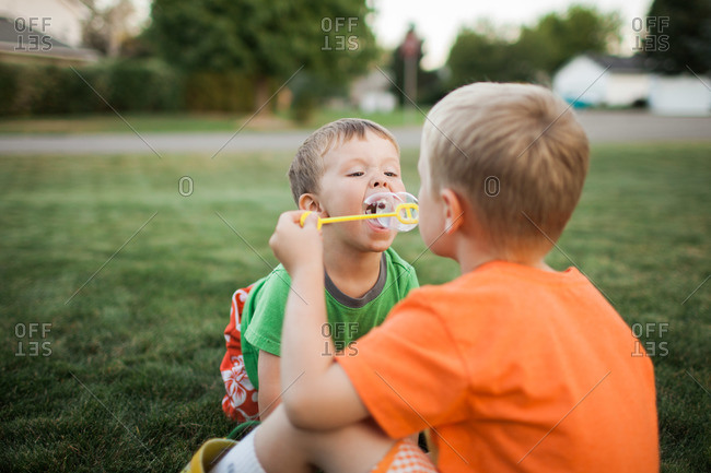 Young boys playing with soap bubbles