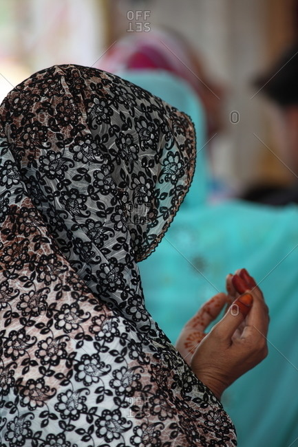 Woman praying at the Bulleh Shah shrine in Kasur, Pakistan