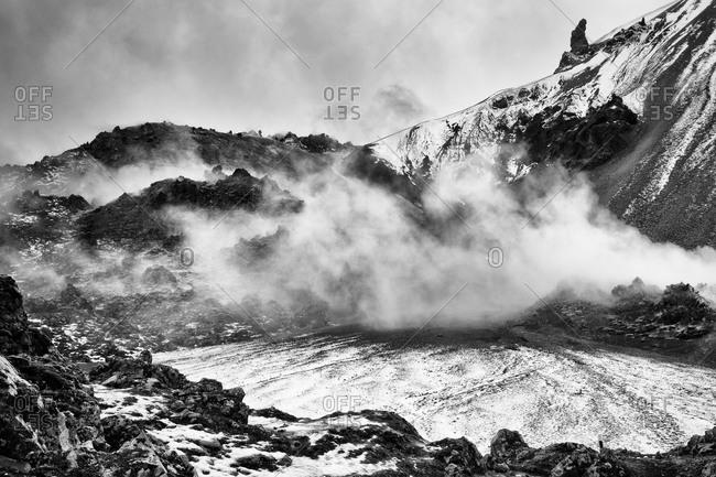 Steam rising from a hot spring in Landmannalaugar, Iceland