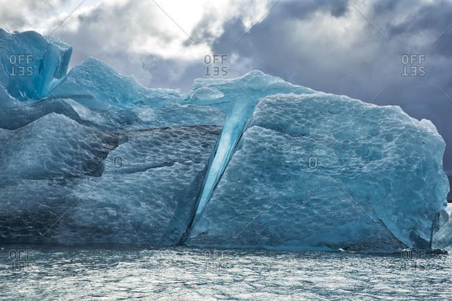Fissure in a blue iceberg in Jokulsarlon lagoon, Iceland