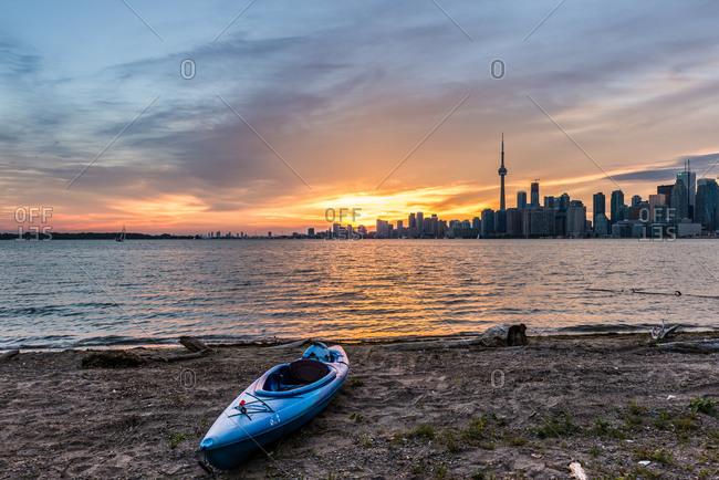 A kayak on the shore of Lake Ontario