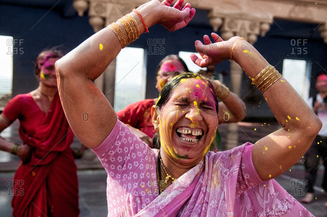 Nandgaon, India - March 10, 2014: Woman dancing and laughing during Holi Festival in Nandgaon, India