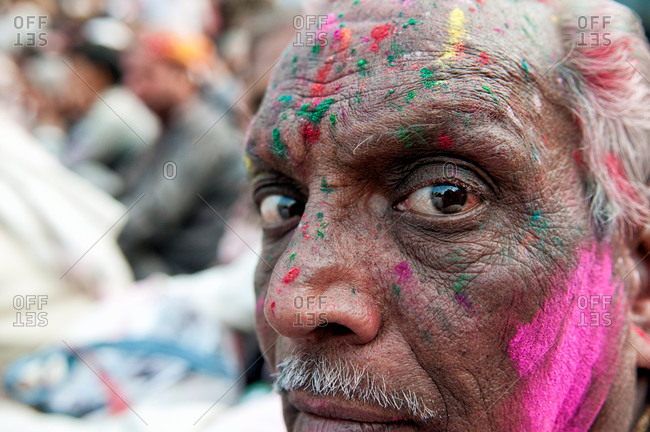 India - March 10, 2014: Close up of a man during Holi Festival in Nadgaon, India