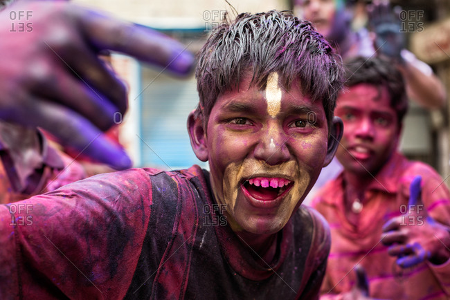 Bikaner, India - March 17, 2014: Children covered in colored powder during Holi Festival in Bikaner, India