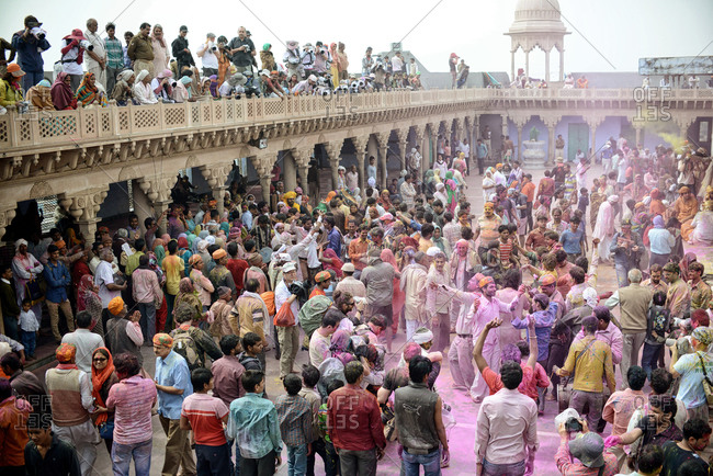 India - March 10, 2014: Pilgrims gathered in a Krishna Temple during Holi Festival in Nandgaon, India