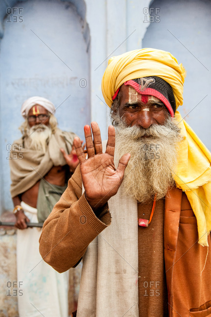 Varanasi, India - March 10, 2014: Sadhu raising his hand in India