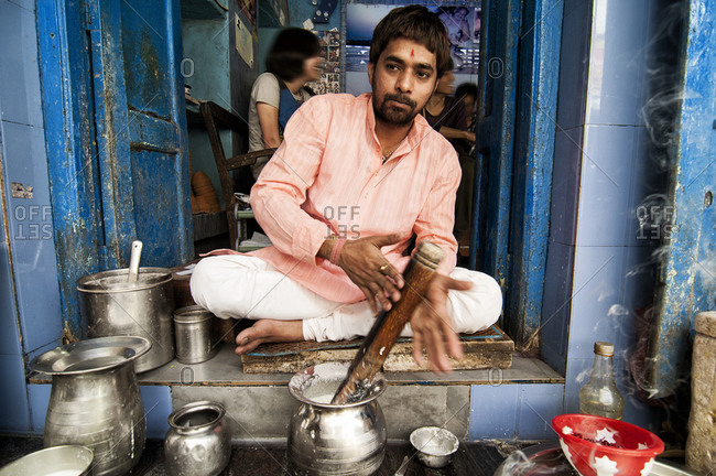 Varanasi, India - March 20, 2014: Man preparing Lassi in Varanasi, India