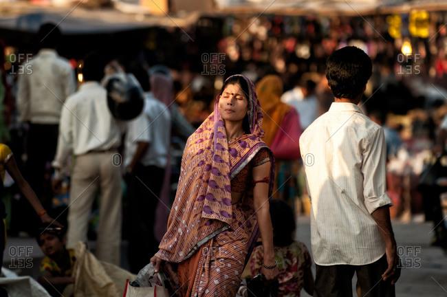Jodhpur, India - March 7, 2014: Woman carrying bags in Jodhpur, India