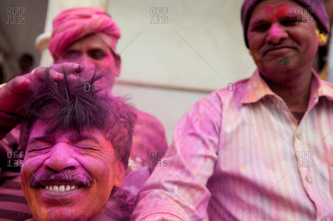 Nandgaon, India - March 10, 2014: Men celebrating the Holi Festival in Nandgaon, India