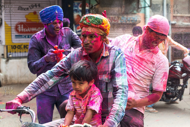 Bikaner, India - March 17, 2014: Man splashing paint on the Holi Festival in Bikaner, India