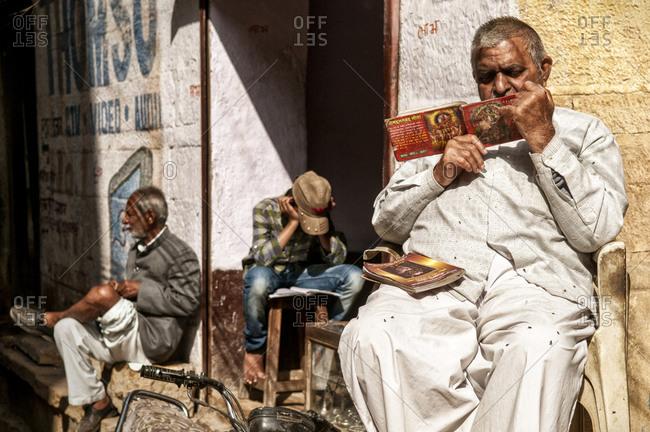 Jaisalmer, India - March 5, 2014: Men sitting on the street in Jaisalmer, India