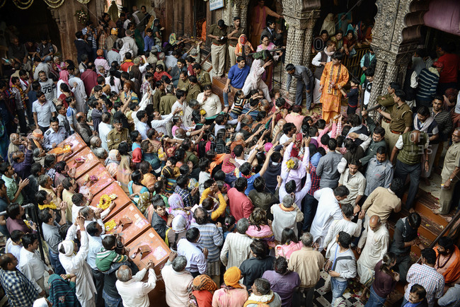 Vrindavan, India - March 11, 2014: Crowd in the temple of Vrindavan during the Holi festival in India