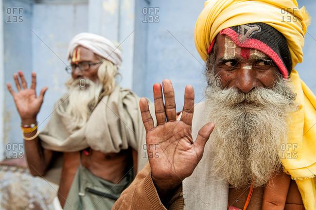 Nandgaon, India - March 10, 2014: Sadhus waving in Nandgaon, India