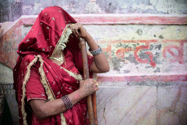 Indian woman hiding her face