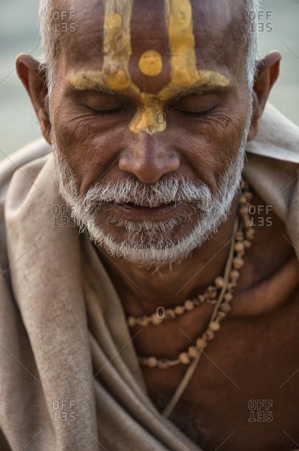 Varanasi, India - March 22, 2014: Portrait of a sadhu during his morning puja in Varanasi, India