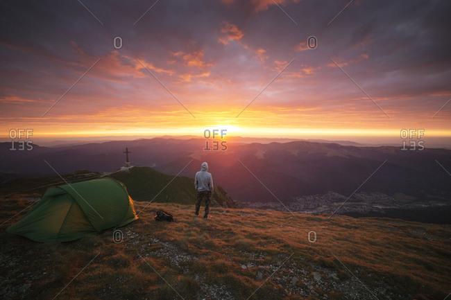 Man camping at sunset