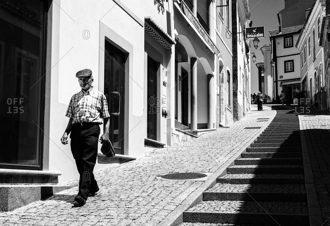 Monchique, Portugal - May 25, 2012: Man walking on the street in Portugal