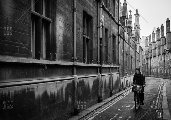 Cambridge, England UK - May 30, 2013: Woman riding a bike