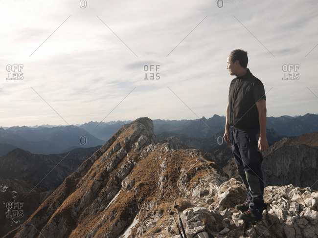 Man standing on rocky alpine summit