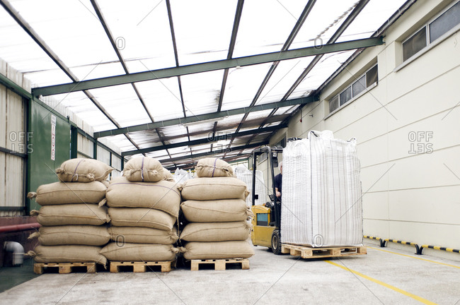Sacks on pallets in factory