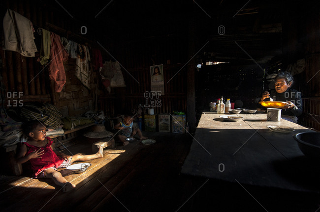 Abra province, Philippines - April 26, 2013: An Igorot family having breakfast in Abra province