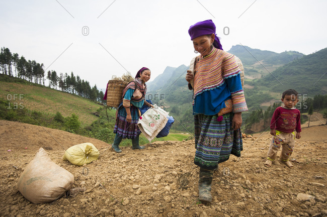 Bac Ha, Lo Cai, Vietnam - May 12, 2012: H'mong women heading out to work in the field
