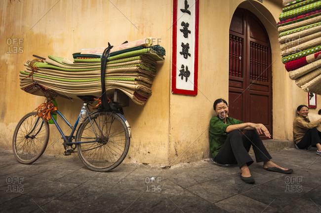 Hanoi, Vietnam - May 5, 2012: A Vietnamese woman laughs on the street