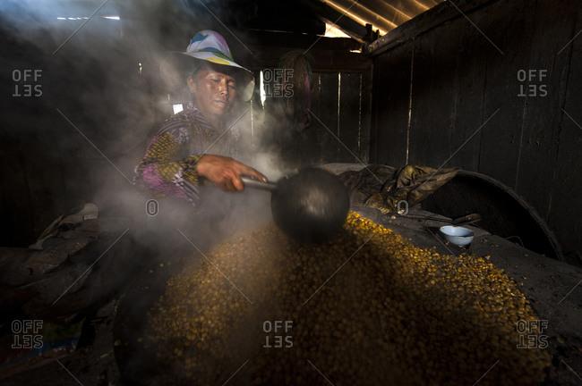 Bac Ha, Lo Cai, Vietnam - May 12, 2012: Flower H'mong woman distilling corn wine