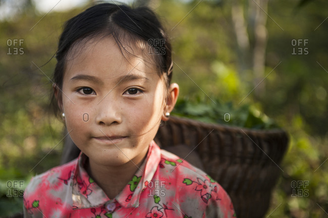 Sa Pa, Lo Cai, Vietnam - May 14, 2012: Tay child carrying a basket on her back