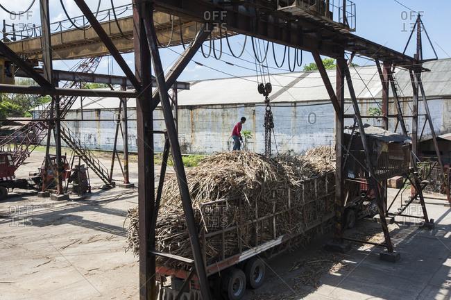 Visayan Island, Philippines - April 2, 2013: Unloading sugar cane at mill