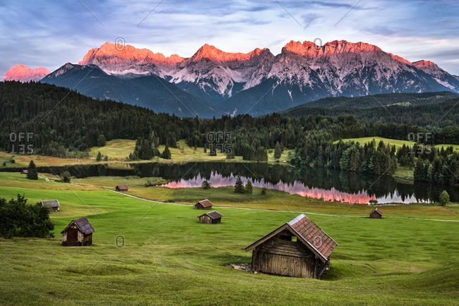 Alpenglow over idyllic Bavarian Landscape with Lake