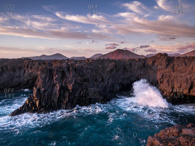 Huge Waves crashing against Wild Volcanic Coast