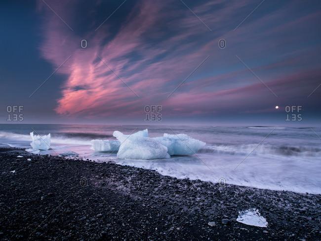 Sunset on Black Beach with Icebergs