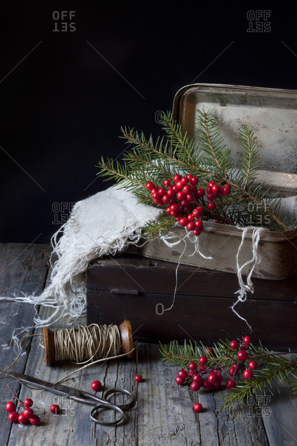 Vintage boxes for Christmas gifts with red berries and pine twigs