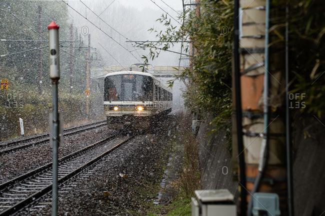 Train moving through snow, Kyoto, Japan