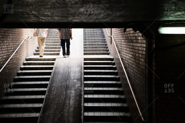 Male passengers leaving subway station, Osaka, Japan