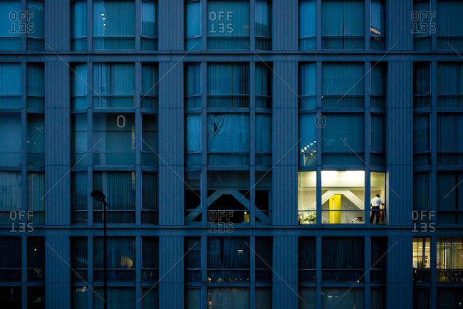 One illuminated window in a large building in the evening, Osaka, Japan