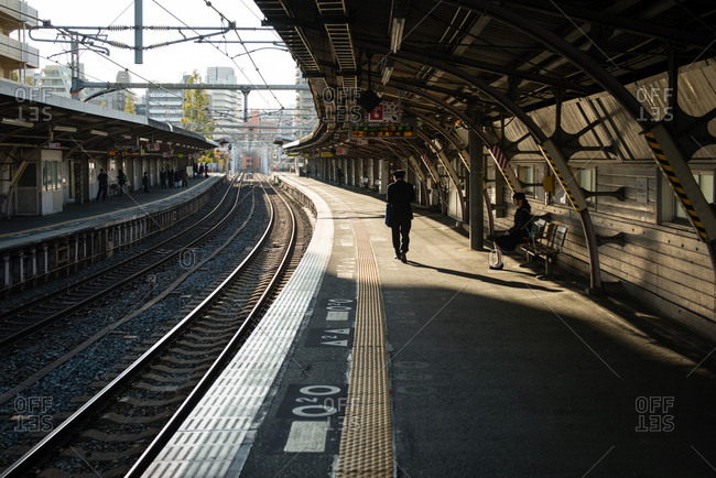 Osaka, Japan - November 15, 2014: Waiting at a train station platform, Osaka