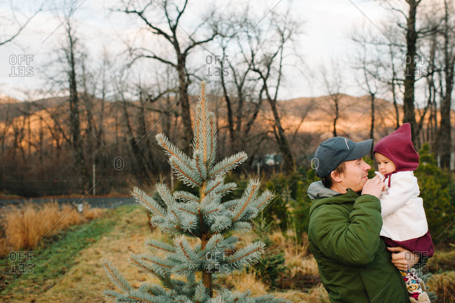 Father and daughter at a Christmas tree farm