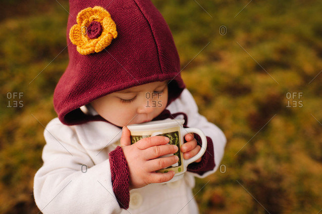 Little girl drinking hot cocoa