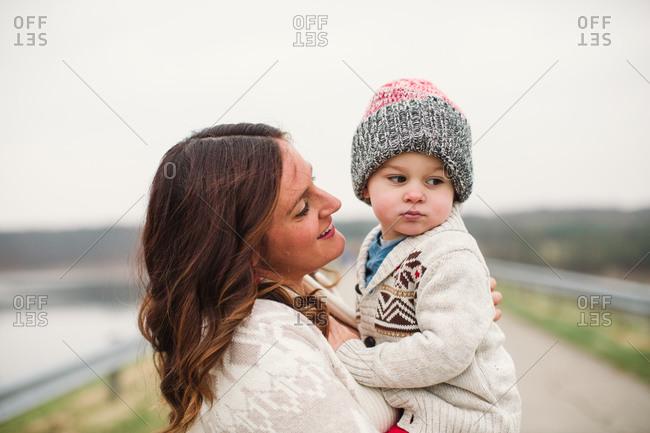 Mother gazes adoringly at her toddler son