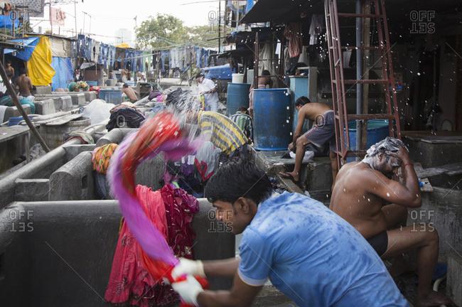 Mumbai, India - October 2, 2013: Dhobis working in a laundromat in Mumbai, India
