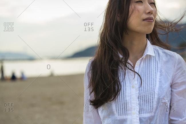 A woman on a beach in Kobe