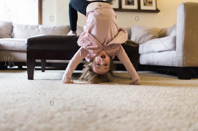 Girl doing backflip in living room