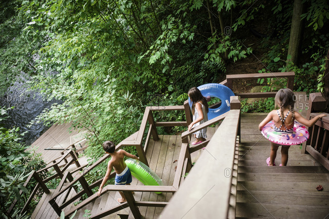 Children head down stairs towards a river