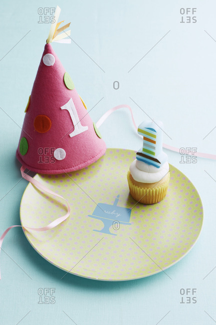 Party hat and a tiny cupcake at a birthday party