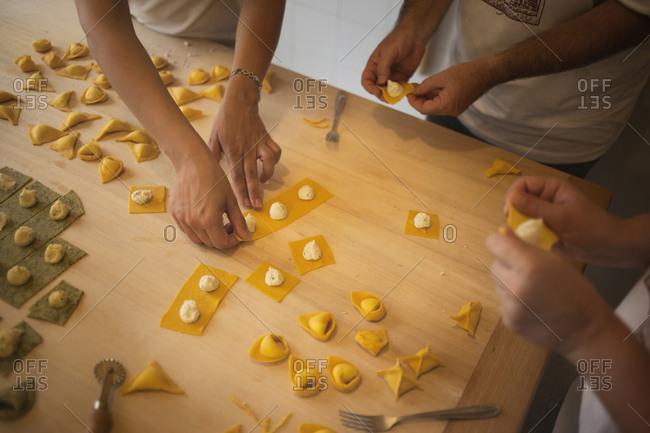 Women preparing pasta in Italy