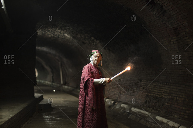 Naples, Italy -September 9, 2010: Man in priestly robes in tunnel